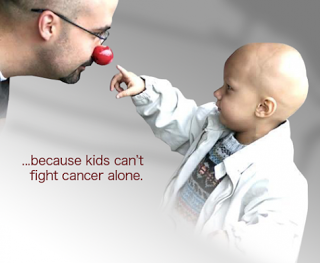 bald child touching a clown's nose