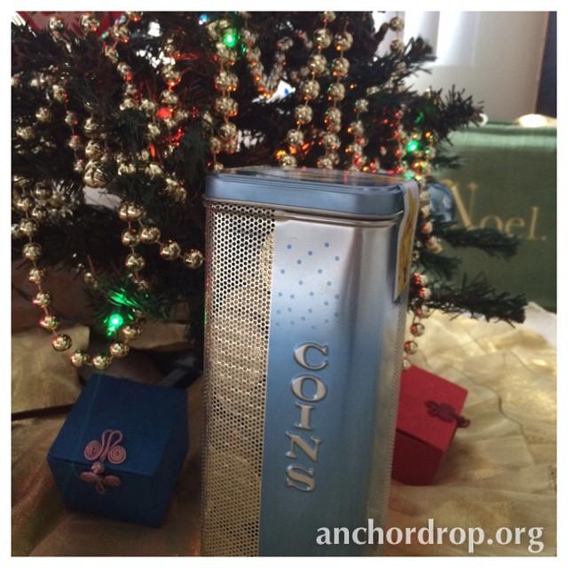 Coin tin under a christmas tree