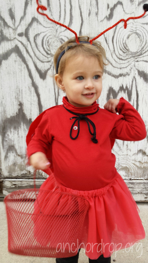 toddler in ladybug costume