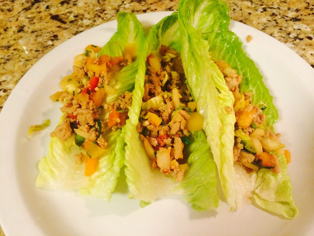 Ground meat and vegetables wrapped in lettuce