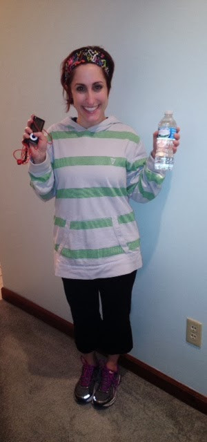 the author in workout gear holding ipod and water bottle