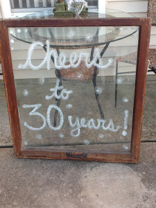 board that says cheers to thirty years