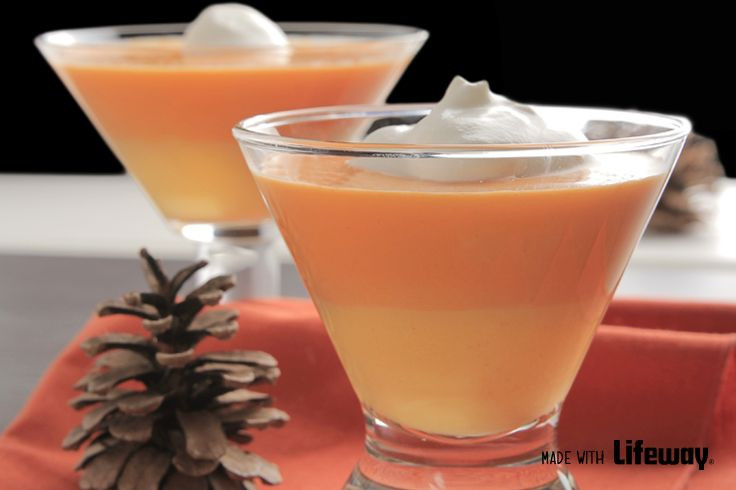 candy corn smoothie in a martini glass