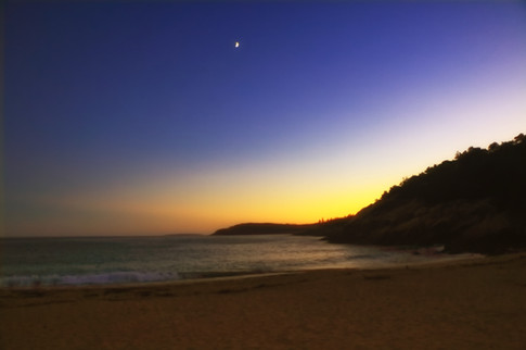 Moon Rising On Sand Beach