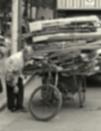 Old lady sells cardboard to buy food.