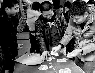 Poker players inside a street market.