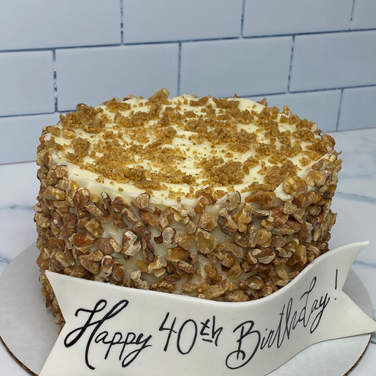 Carrot Cake with cream cheese buttercream and toasted walnuts