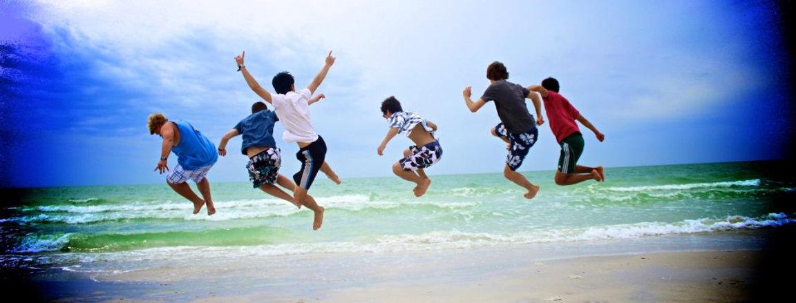 jumping for joy at the beach.jpg