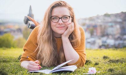 happy woman writing.jpg