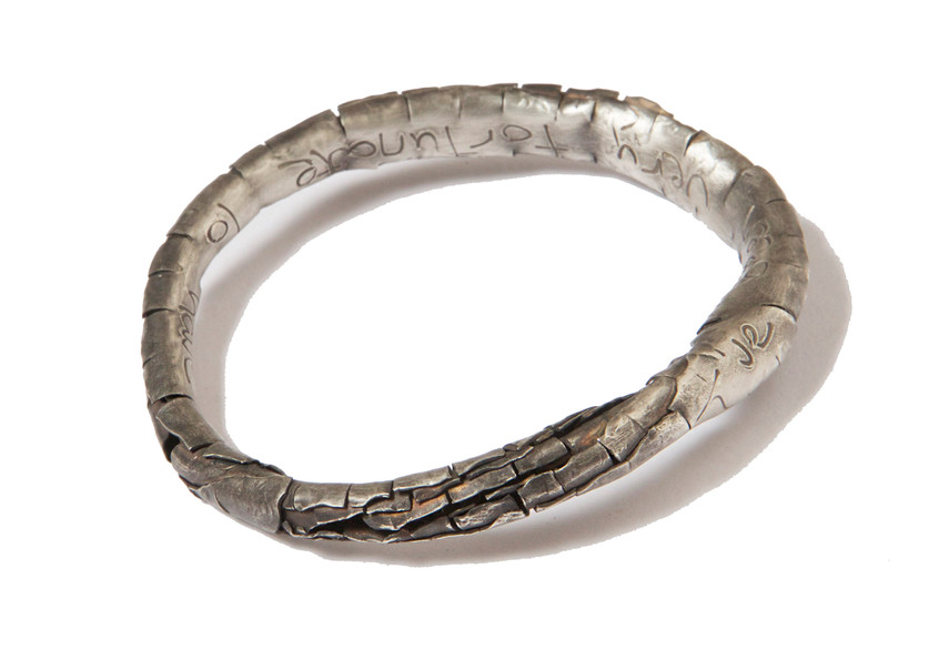 Silver-plated bangle with engraved words