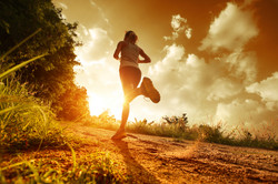 bigstock-Young-lady-running-on-a-rural--