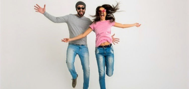 hipster-stylish-couple-jumping-isolated-
