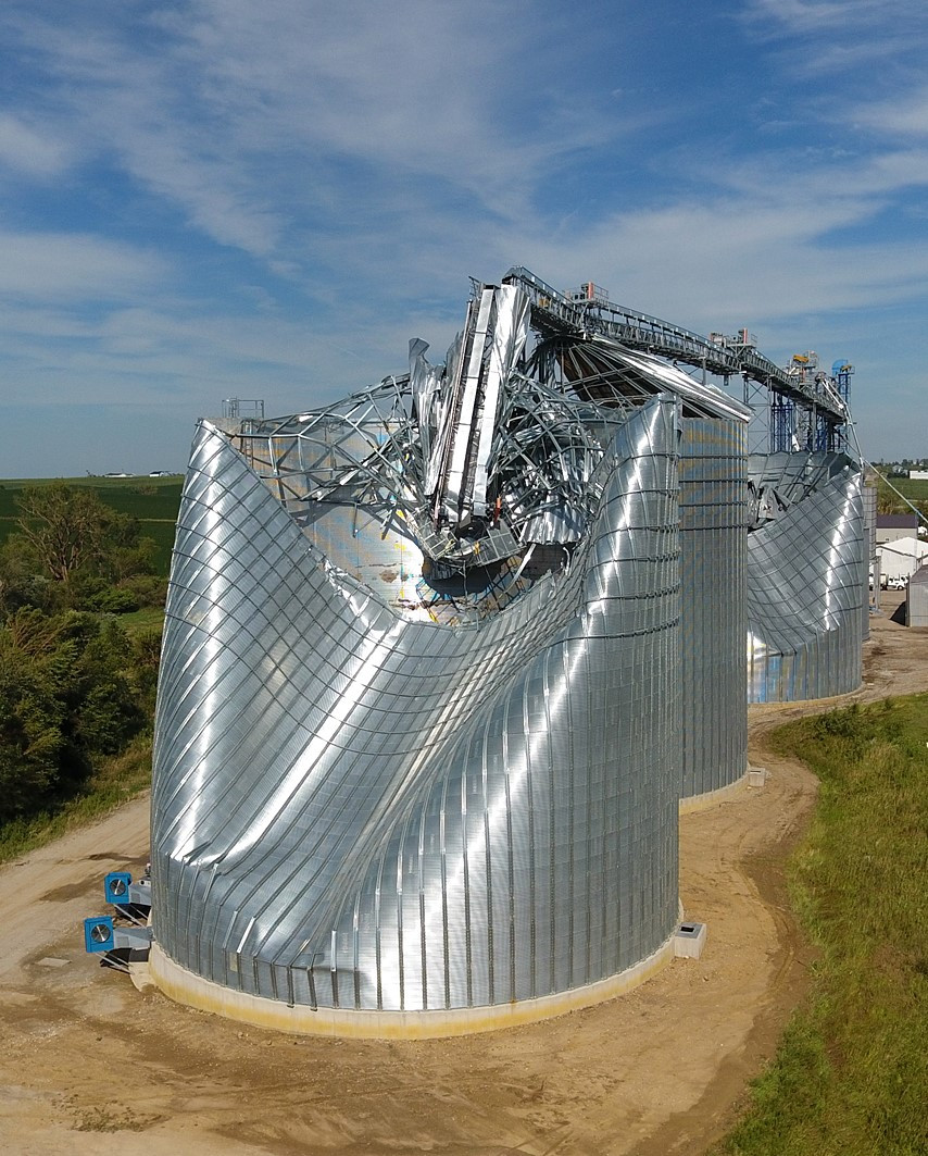 Image is wind-damaged grain bins.