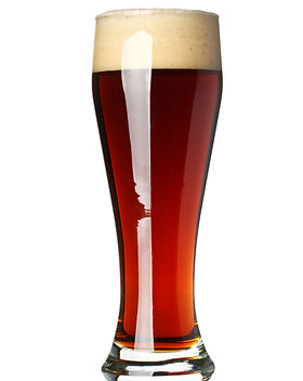 Glass with dark beer on a white backgrou