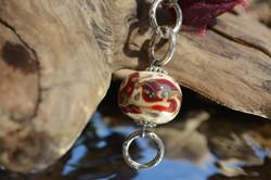 collier boule ivoire &rouge