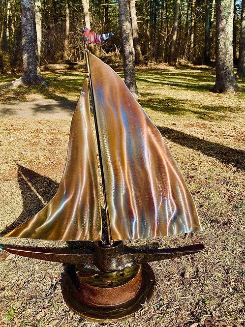 golden metal sailboat