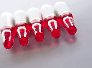 Several medical ampoules with red liquid