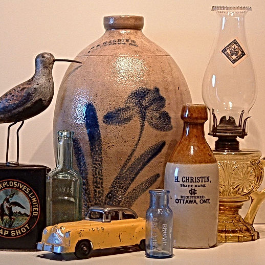 H. Christin Ottawa Ginger Beer, oil lamp, tin car, antique shore bird decoy, stoneware crock with cobalt blue flower, hunting tin, medicine bottle