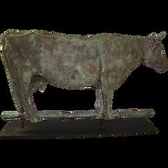 Antique weathered metal cow weather vane