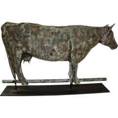 Antique weathered metal cow weather vane