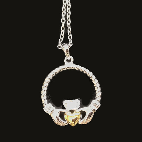 Platinum Plated Claddagh Pendant with Yellow Gold Hearts
