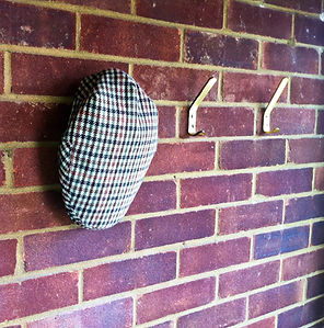 Tweed hat and brick wall.jpg