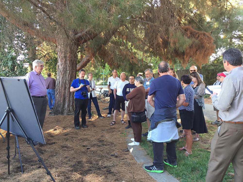 Richard Harper addressing a crowd outside