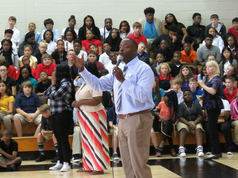 Principal Ray speaking to students.