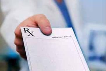 doctor-with-prescription-pad.jpg