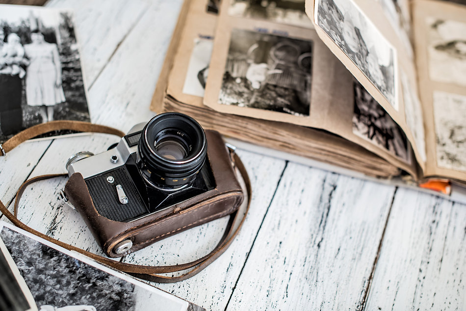 An old film camera and family album on a