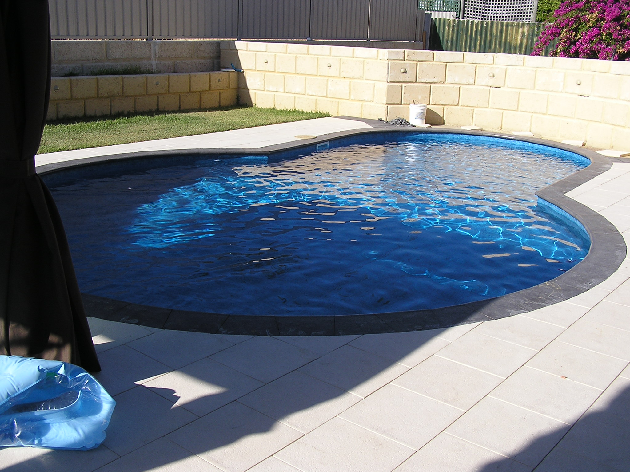 Pool paving and limestone feature