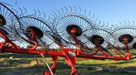 Hay rake against central Oregon's blue sky