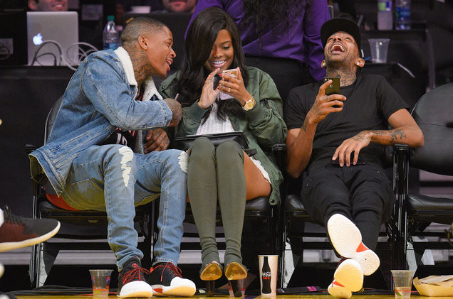 YG, Karen Civil and Nipsey Hussle attend a basketball game between the Houston Rockets and the Los Angeles Lakers at Staples Center on Oct. 26, 2016 in Los Angeles. Credit: Noel Vasquez/GC Images
