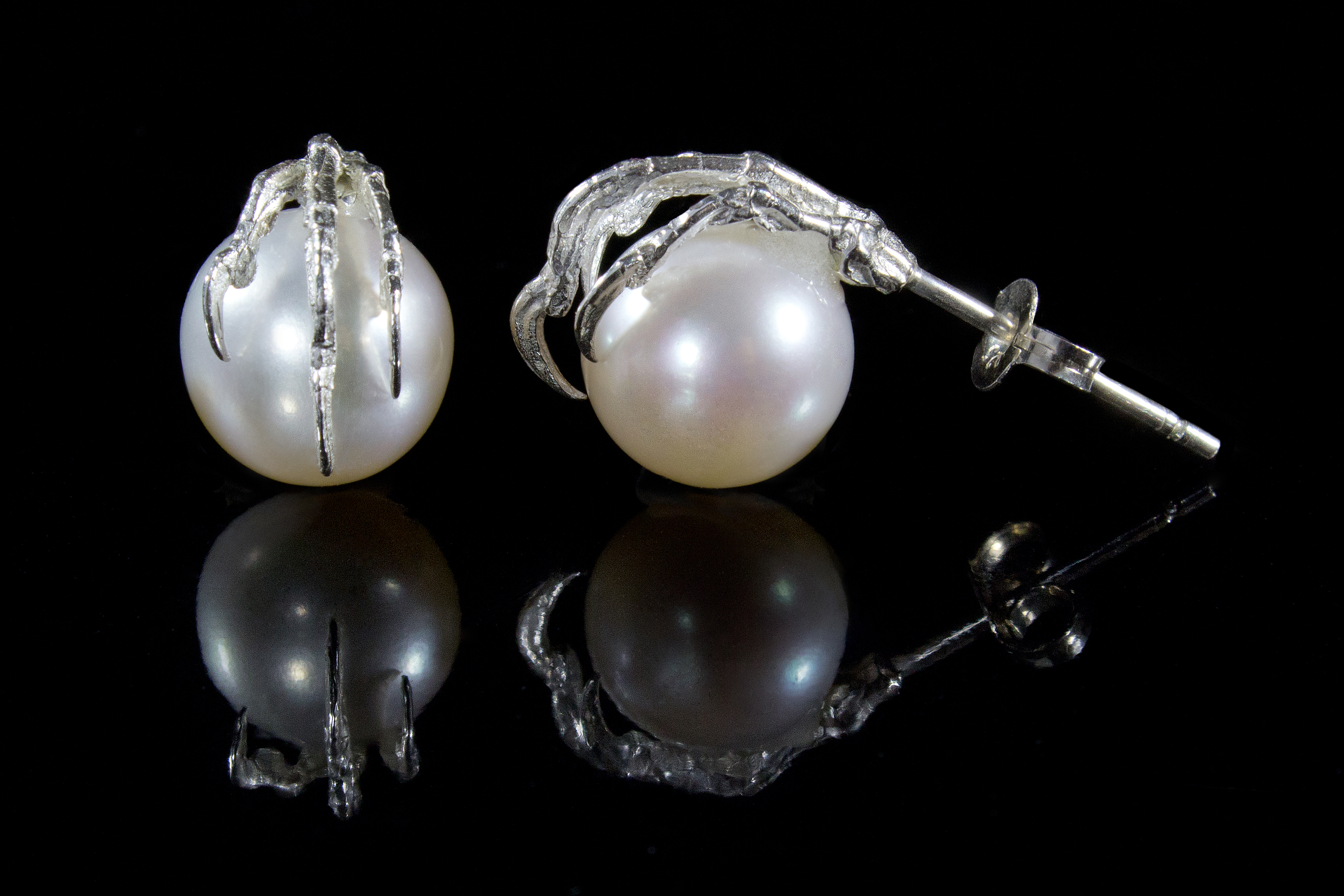 Clutching Pearl studs
