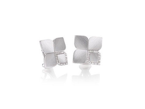 Ladies sterling silver earrings with wht sapphires