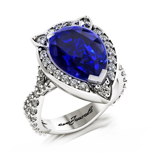 18ct White gold pear cut deep blue tanzanite ring with a halo of diamonds