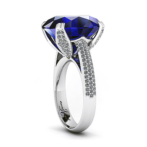18ct White gold 15ct oval tanzanite dress ring claw set with pave diamonds