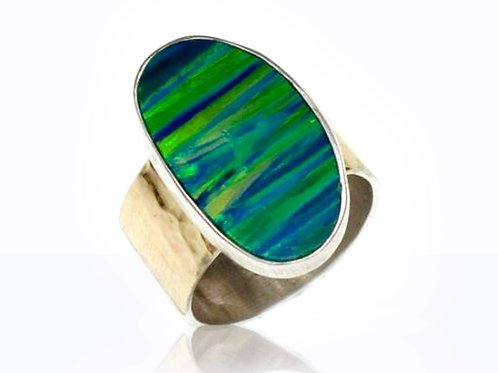 Israel designer dress ring with a blue and green opal