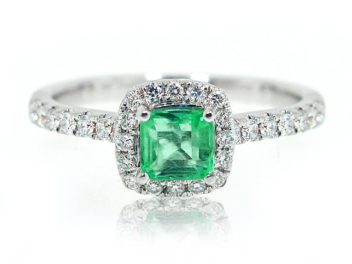 18ct White gold cushion green emerald ring with a halo of diamonds