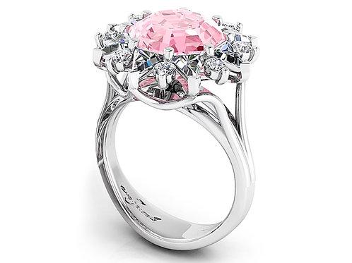 round pink tourmaline dress ring with a halo of diamonds