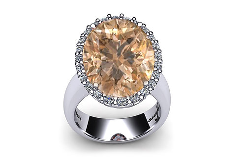 18ct White gold oval morganite ring with a halo of grain set diamonds