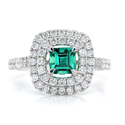 Cushion Cut Emerald Ring with a Double Diamond Halo