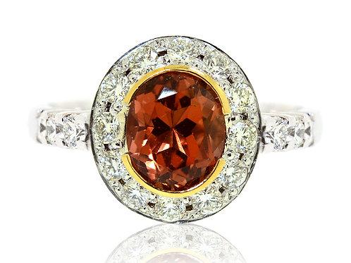 18ct White gold Orange Tourmaline ring with a halo of diamonds