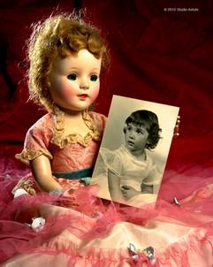 Doll Holding Little Girl