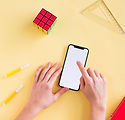top-view-phone-mock-up-yellow-background