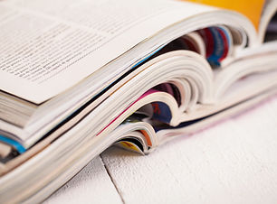 pile-colorful-magazines-table.jpg