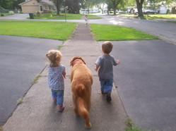 Nora, Maya and Carson on a walk