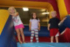 Kids enjoying the 17 Foot Tall Inflatable Slide