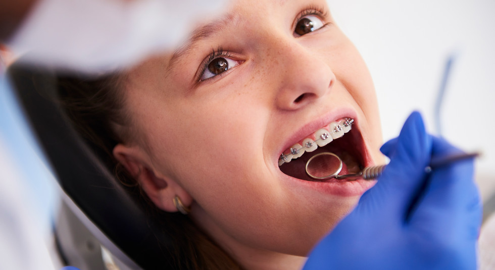girl-with-braces-during-routine-dental-examination.jpg