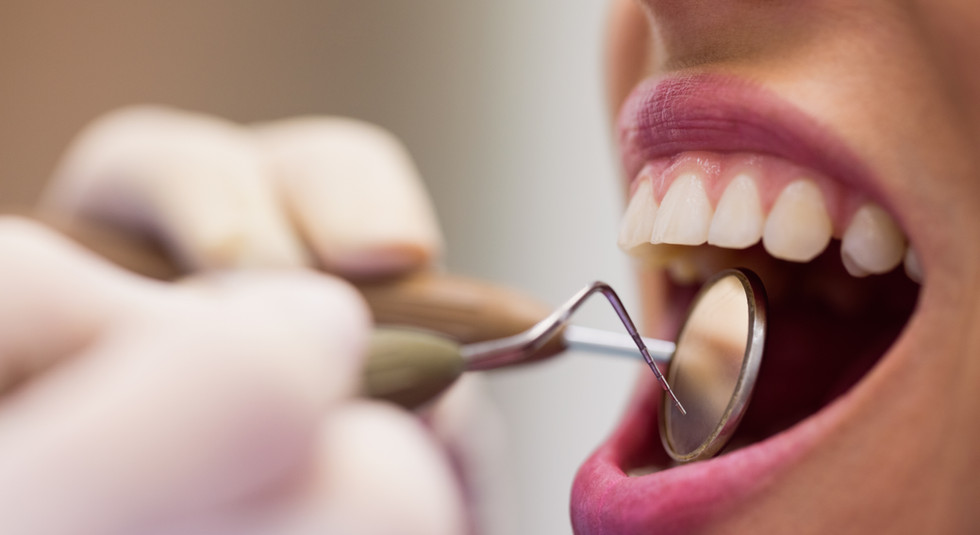 dentist-examining-female-patient-with-tools.jpg